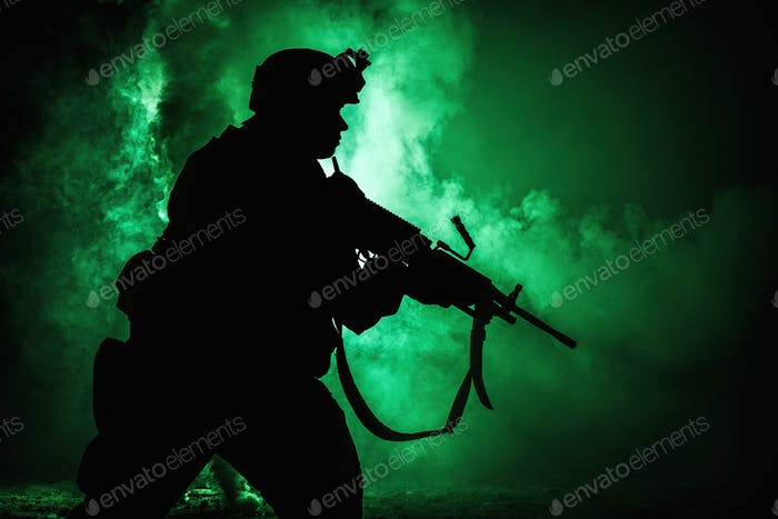 Soldiers silhouette on background of fire explosion