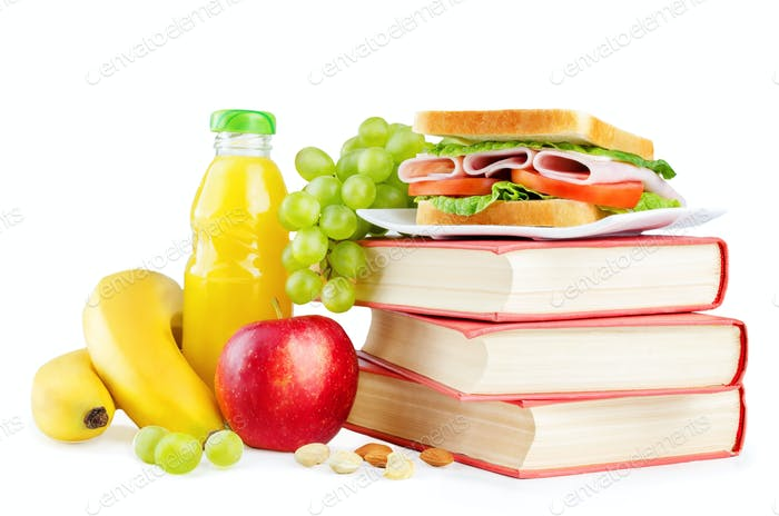 school lunch with a sandwich, fresh fruits and juice isolated