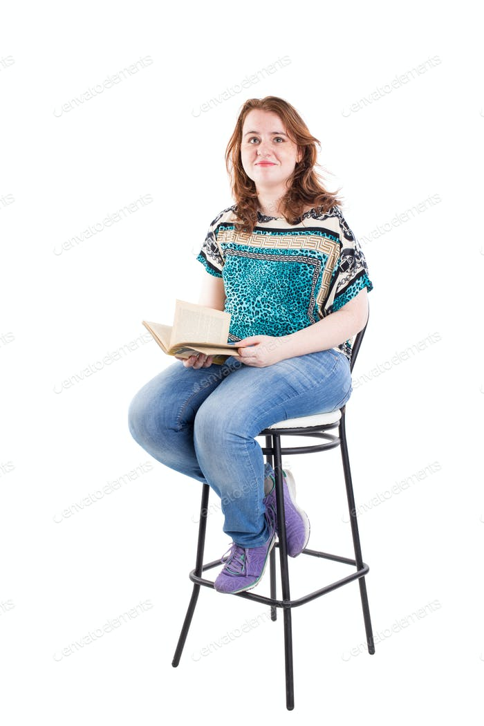 Beautiful redhead plus size model with book.