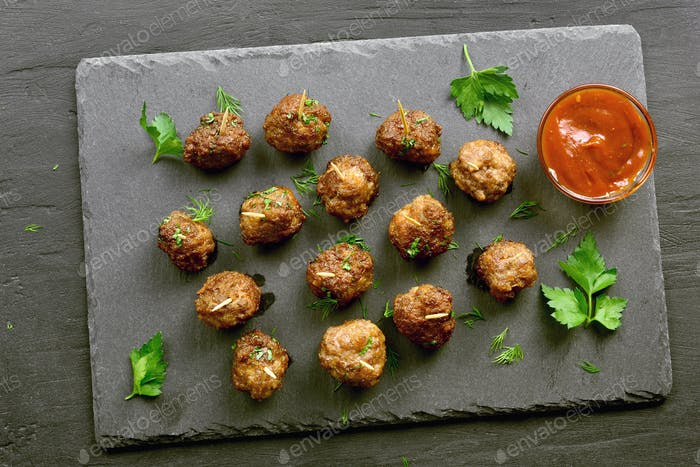 Delicious meatballs with tomato sauce