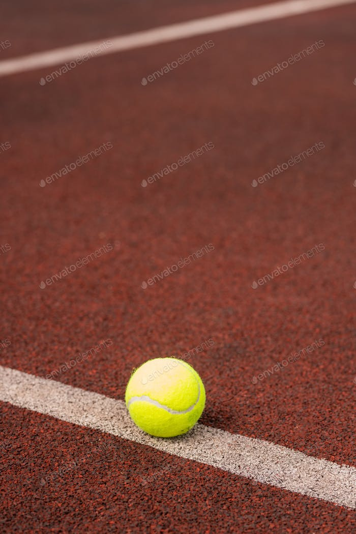Single yellow ball for playing tennis on white line