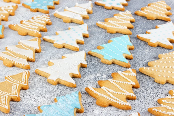 Christmas pattern of ginger cookies in the shape of Christmas tree