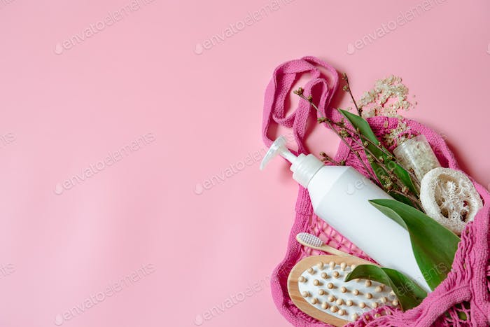Spa composition with products for beauty and health in a string bag copy space.