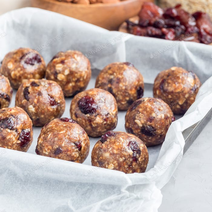 Healthy homemade energy balls with cranberries, nuts, dates and rolled oats, square