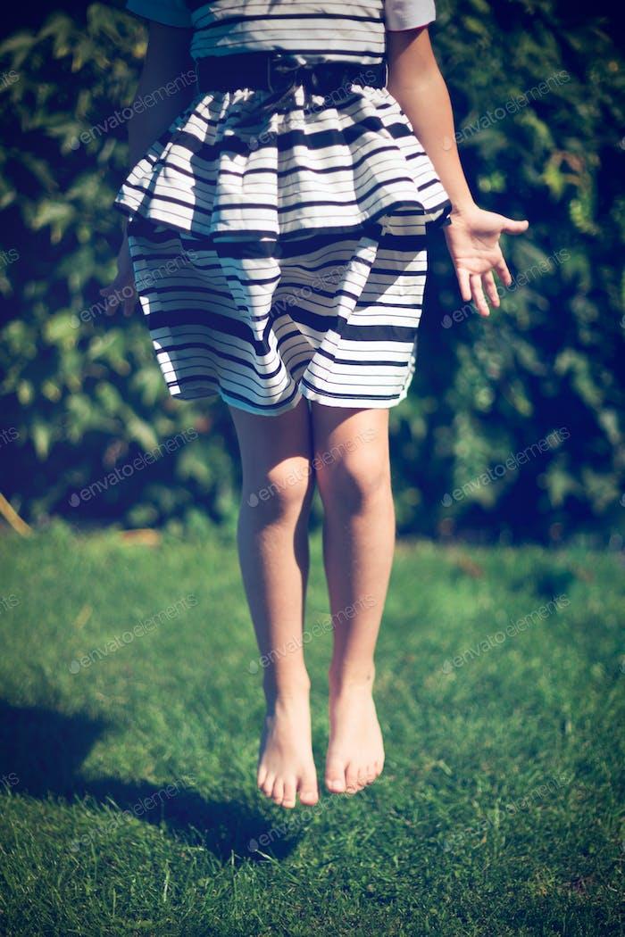 Little girl jumps.