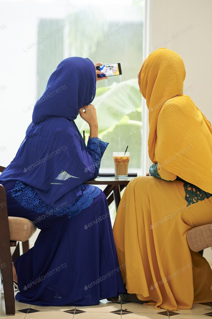 Woman in hijabs taking selfie