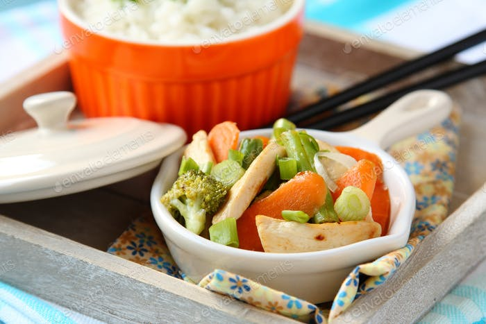 Chicken stir fry with vegetables and rice