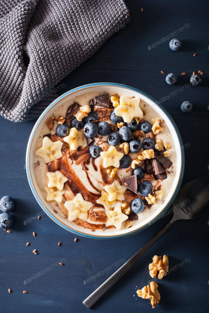 healthy banana smoothie bowl with blueberry chocolate walnuts