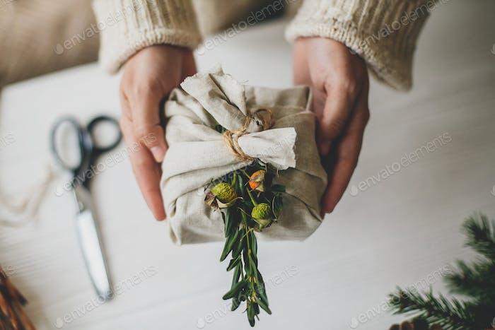 Female preparing plastic free christmas present