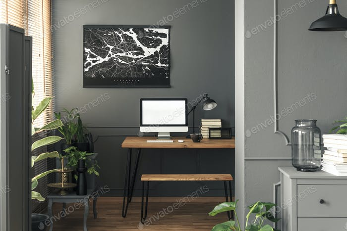 Real photo of dark open space living room interior with map post