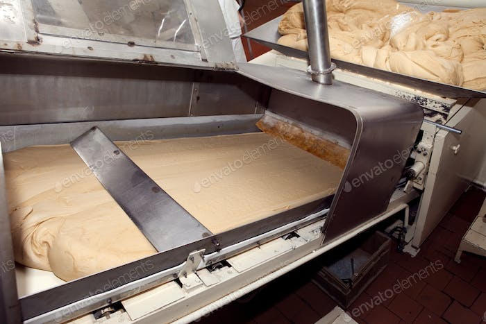 machine for making cookies in the factory. Conveyor belt with Cookie dough