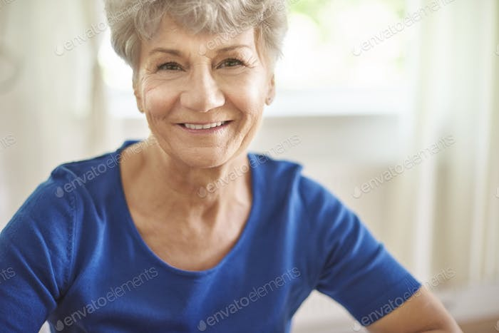Portrait of cheerful and attractive senior woman