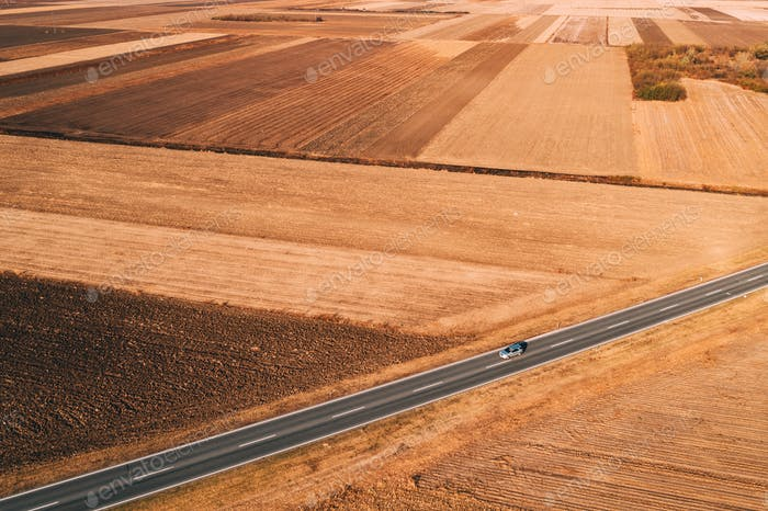 Aerial view of cars driving on the road