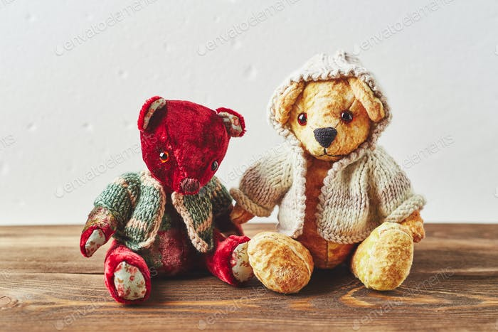 TwoTeddy bears on wooden background