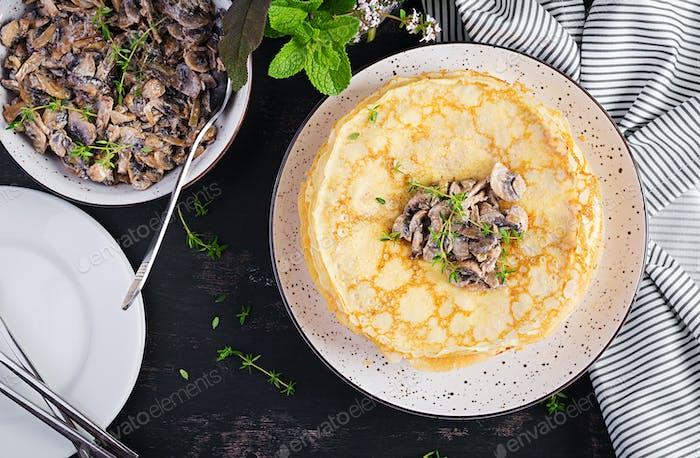Pancakes with mushrooms.  Homemade baking. Maslenitsa week. Maslenitsa. Top view, copy space