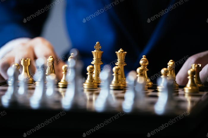 Unrecognizable male thinking over chess