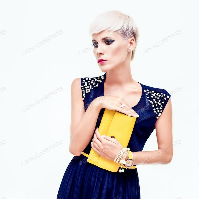 portrait of a beautiful girl in evening dress with a clutch
