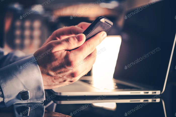 Businessman with Mobile Devices