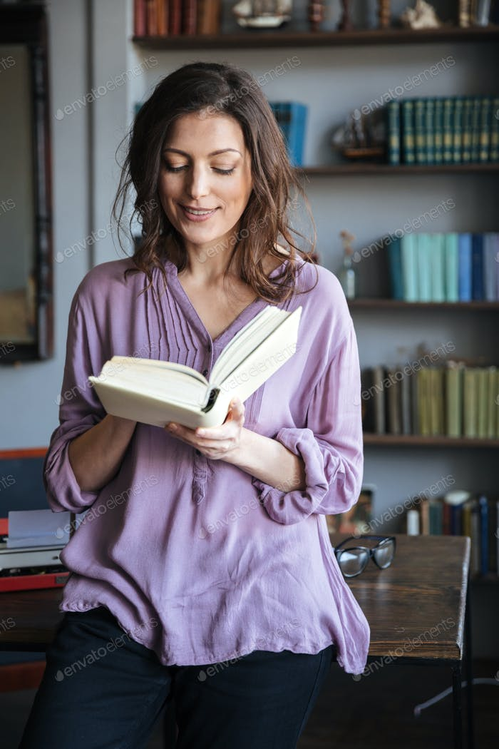 Portrait of a smiling casual mature woman reading book