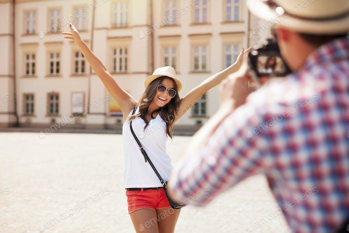 Happy tourist girl posing for photo