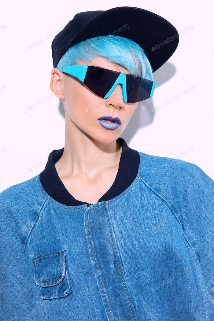 fashion Model with short blue colored hair and make up. Trendy haircut concept