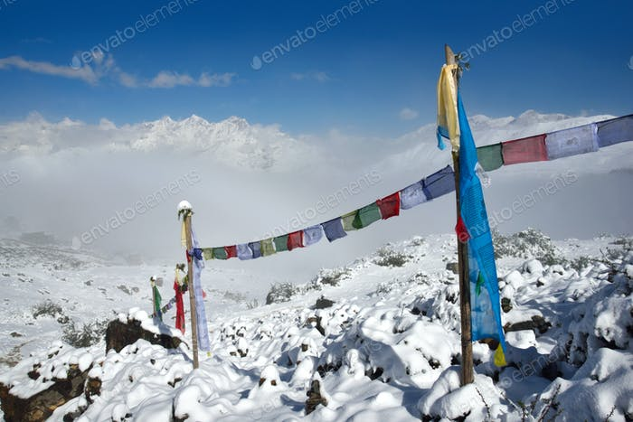 Buddhist Prayer flags against Himalayas snowy peaks