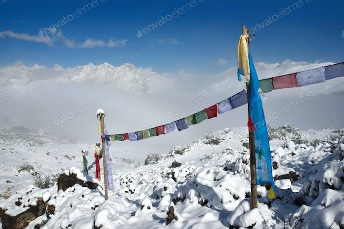 Buddhist Prayer flags against Himalayas snowy peaks