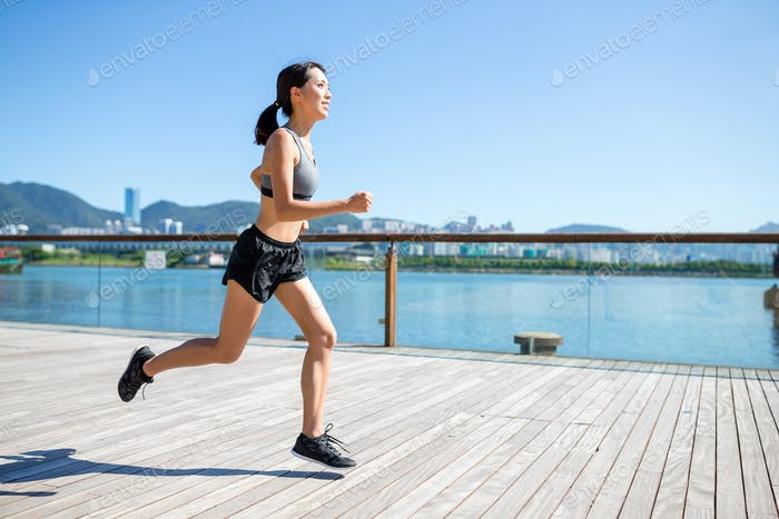 Young Woman jogging on the boardwalk