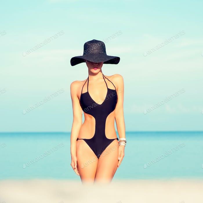 sensual fashion girl on the beach