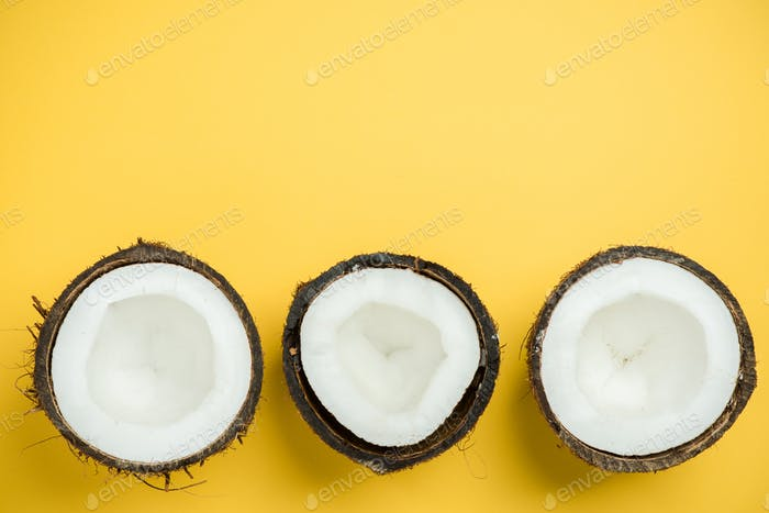 Creative flat lay coconut on pastel background