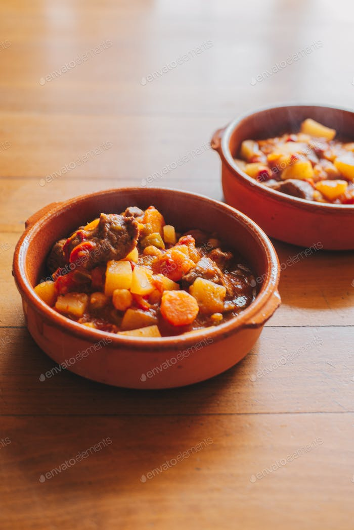 potatoes and meat stew on a clay container