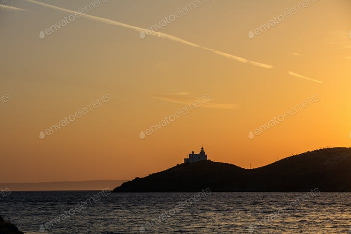 Greece, Kea island. Lighthouse at sunset