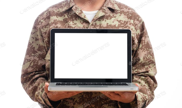 Young soldier showing a laptop with blank screen on white background