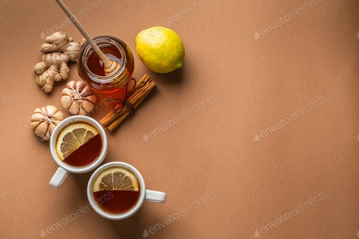 Natural cold, flu home remedies: hot tea cups with lemon