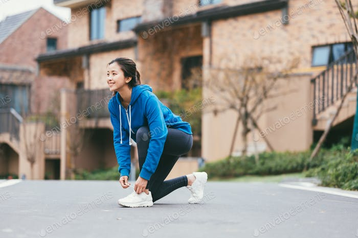 Young Asian woman running outdoors