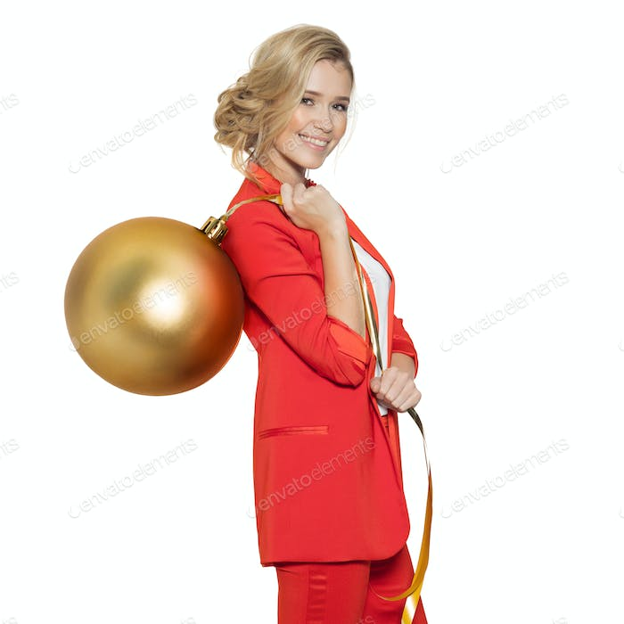 Charming Woman Holding Big Golden Tree Ball. Happy New Year.