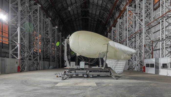Aerostat in a huge aircraft hangar