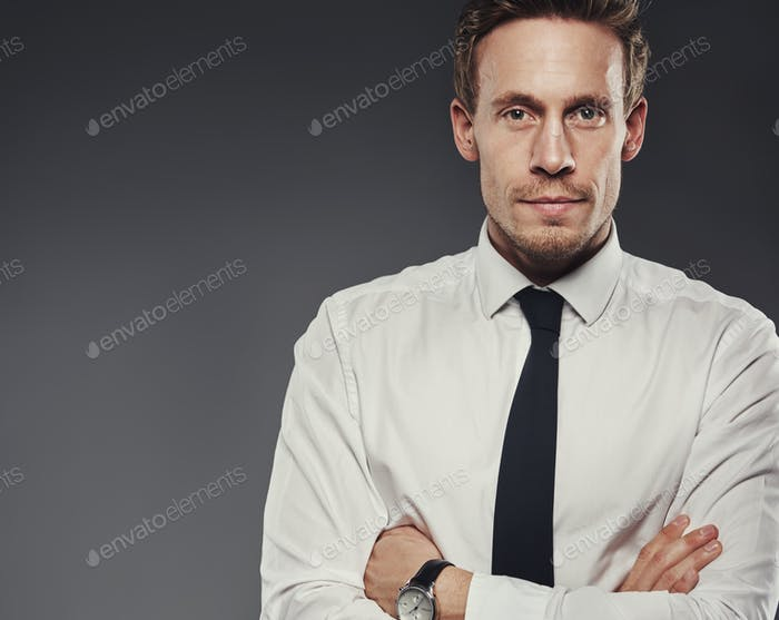 Stern grim businessman with folded arms