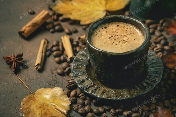 Black coffee with autumn leaves
