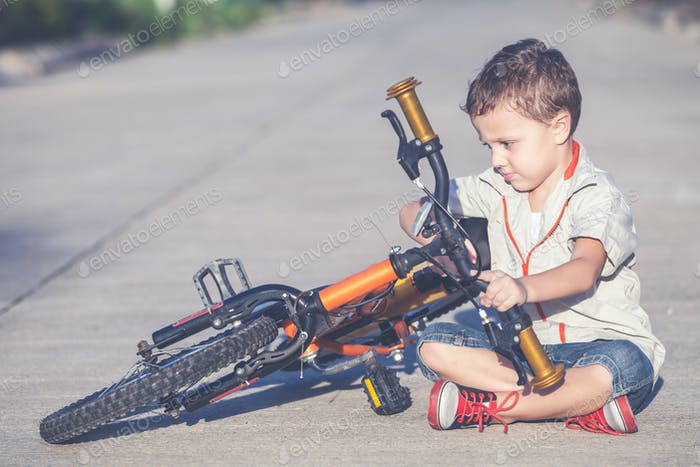 Happy little boy with bicycle