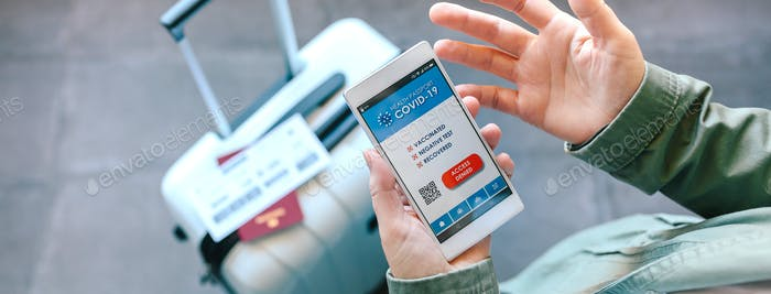 Hands holding a mobile with denied covid passport