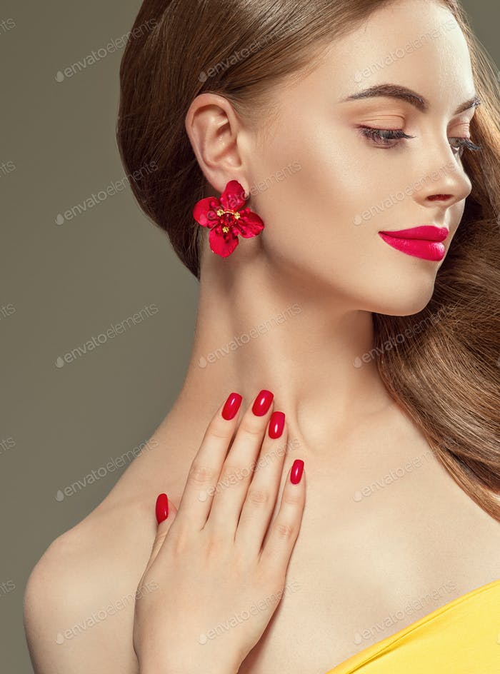 Beautiful woman long beauty hairstyle red lips manicured nails. Female portrait. Studio shot.