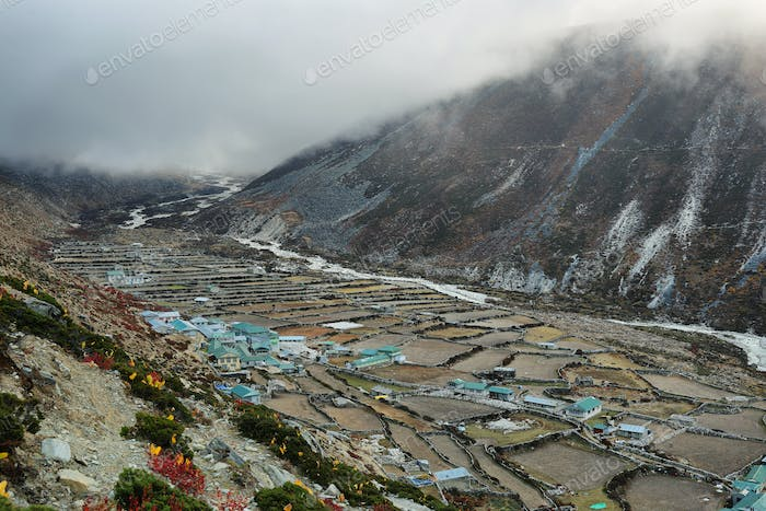 Dingboche village with clouds approaching