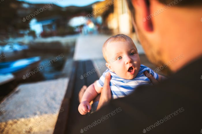 Unrecognizable man with baby son enjoying their time at seaside.