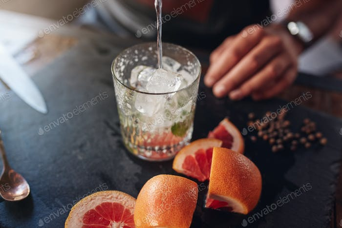 Bartender preparing cocktail.
