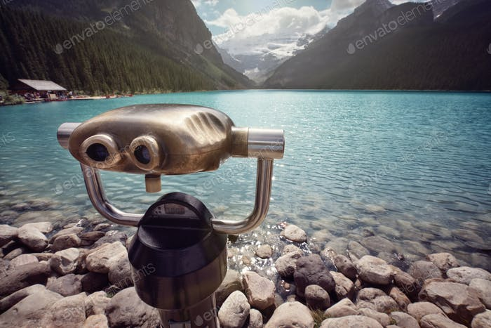 Looking at view across Lake Louise through binoculars
