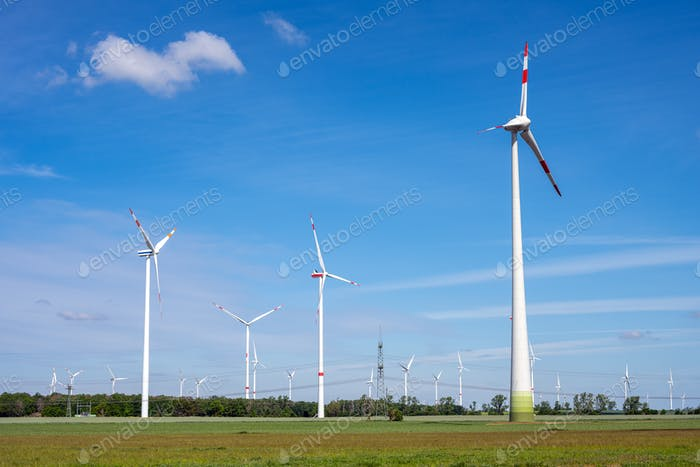 Modern wind turbines in an agricultural area