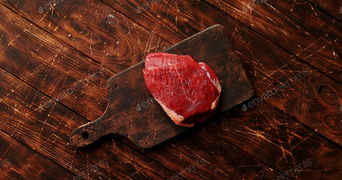Raw meat on chopping board