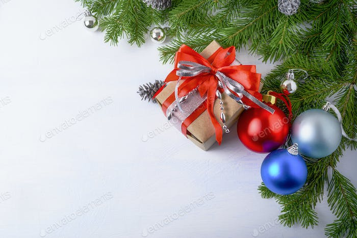 Christmas background with gift box and ornaments copy space