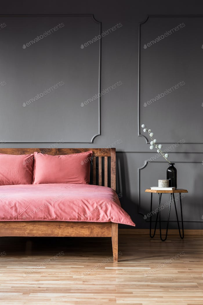Real photo of a simple and elegant bed with dirty pink bedding n
